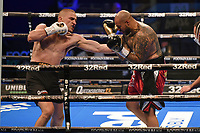Michal Soczynski (black shorts) defeats Matt Sen during a Boxing Show at the SSE Arena on 24th July 2021