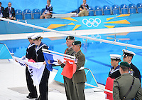 July 30, 2012..Lto R: Flag of Korea, France and China being raised during medal presentation ceremony for Men's 200m Freestyle event at the Aquatics Center on day three of 2012 Olympic Games in London, United Kingdom.