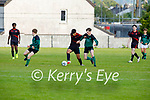 Rodrico Pihino been well marked by Donagh Murphy of  Fenit Samphires in the U16 Soccer league
