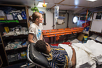 Sea Watch-2.<br /> Die Sea Watch-2 bei ihrer 13. SAR-Mission vor der libyschen Kueste.<br /> Im Bild: Medizinische Versorgung an Bord der Sea Watch-2.<br /> 20.10.2016, Mediterranean Sea<br /> Copyright: Christian-Ditsch.de<br /> [Inhaltsveraendernde Manipulation des Fotos nur nach ausdruecklicher Genehmigung des Fotografen. Vereinbarungen ueber Abtretung von Persoenlichkeitsrechten/Model Release der abgebildeten Person/Personen liegen nicht vor. NO MODEL RELEASE! Nur fuer Redaktionelle Zwecke. Don't publish without copyright Christian-Ditsch.de, Veroeffentlichung nur mit Fotografennennung, sowie gegen Honorar, MwSt. und Beleg. Konto: I N G - D i B a, IBAN DE58500105175400192269, BIC INGDDEFFXXX, Kontakt: post@christian-ditsch.de<br /> Bei der Bearbeitung der Dateiinformationen darf die Urheberkennzeichnung in den EXIF- und  IPTC-Daten nicht entfernt werden, diese sind in digitalen Medien nach §95c UrhG rechtlich geschuetzt. Der Urhebervermerk wird gemaess §13 UrhG verlangt.]