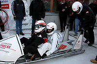 epa01234947 Pilot Prince Albert Grimaldi of Monaco (L-R), and his girl friend Charlene Wittstock, and brakesman Thomas Mark at the start of the third Monaco historic bobsled race in St. Moritz, Switzerland, 25 January 2008.  EPA/ARNO BALZARINI