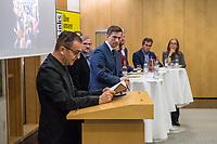 """Buchvorstellung """"Unter Sachsen - Zwischen Wut und Willkommen"""" in Berlin.<br /> Der Sammelband aus dem Christoph Links-Verlag zum Thema Rassismus und rechter Gewalt im Freistaat Sachsen, herausgegeben von der freien Journalistin Heike Kleffner und dem Tagesspiegel-Redakteur Matthias Meisner, wurde am Donnerstag den 30. Maerz 2017 in Berlin vorgestellt.<br /> Auf dem Podium diskutierten der saechsische Vize-Ministerpraesident Martin Dulig (SPD), der saechsische CDU-MdB Marco Wanderwitz, die Linken-Chefin Katja Kipping gemeinsam mit dem Verleger Christoph Link, den Herausgebern Heike Kleffner und Matthias Meisner sowie zwei der 40 Autoren - Michael Bittner und Imran Ayata - ueber das Buch.<br /> In dem Buch suchen die Herausgeber Antworten auf die Frage warum und wie es zu den """"saechsischen Verhaeltnissen"""" kommen konnte. Mit 477 offiziell dokumentierten  fremdenfeindlich motivierte Gewalttaten im Jahr 2015 liegt Sachsen, in Bezug auf die Einwohnerzahl, bundesweit an der Spitze.<br /> Die Landesvertretung des Freistaat Sachsen hatte es abgelehnt die Buchvorstellung in ihren Raeumen stattfinden zu lassen, so dass der Verlag den Sammelband vor ca. 250 Gaesten in der Landesvertretung Thueringen praesentierte.<br /> Im Bild: Imran Ayata liest aus seinem Beitrag fuer den Sammelband. Rechts von ihm das Podium mit Martin Dulig, Christoph Links, Michael Bittner, Katja Kipping, Marco Wanderwitz, Matthias Meisner, Heike Kleffner.<br /> 30.3.2017, Berlin<br /> Copyright: Christian-Ditsch.de<br /> [Inhaltsveraendernde Manipulation des Fotos nur nach ausdruecklicher Genehmigung des Fotografen. Vereinbarungen ueber Abtretung von Persoenlichkeitsrechten/Model Release der abgebildeten Person/Personen liegen nicht vor. NO MODEL RELEASE! Nur fuer Redaktionelle Zwecke. Don't publish without copyright Christian-Ditsch.de, Veroeffentlichung nur mit Fotografennennung, sowie gegen Honorar, MwSt. und Beleg. Konto: I N G - D i B a, IBAN DE58500105175400192269, BIC INGDDEFFXXX, Kontakt: post@chr"""
