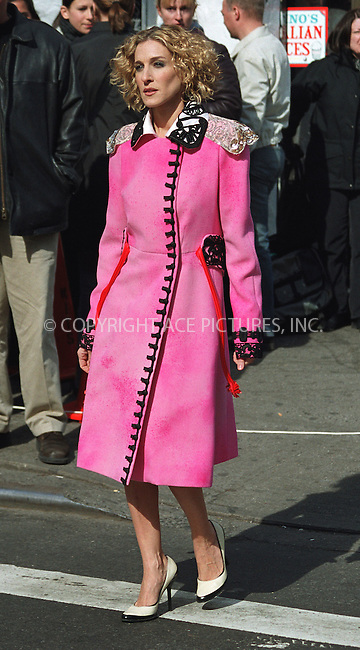 """Actress SARAH JESSICA PARKER doing a promotional photo shoot for HBO's show, """"Sex and the City"""" in New York's West Village. April 6, 2002. Last Friday, HBO announced that as of next Wednesday the network is suspending production of """"Sex and the City"""" until they figure out how to incorporate Ms. Parker's pregnancy into the show. Please byline: Alecsey Boldeskul/NY Photo Press.   ..*PAY-PER-USE*      ....NY Photo Press:  ..phone (646) 267-6913;   ..e-mail: info@nyphotopress.com"""