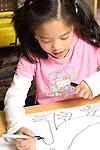Education elementary school grade 2 girl working on drawing