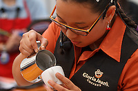 MELBOURNE, 18 MAY 2014 - Rie Moustakas from Australia competing in the final of the 2014 World Latte Art Championship at the Melbourne Show Grounds in Melbourne, Australia. Christian Ullrich of Germany won the championship from Chiara Bergonzi of Italy and Edit Juhasz of Hungary. Photo Sydney Low /  asteriskimages.com