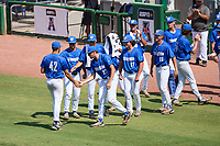 Memphis Tigers pitcher Carson Stinnett (42) is greeted by teammates after being pulled during a game against the East Carolina Pirates on May 25, 2021 at BayCare Ballpark in Clearwater, Florida.  Memphis defeated ECU 11-1 in the opening game of the American Athletic Conference Tournament.  (Mike Janes/Four Seam Images)