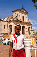 School child portrait  in uniform in front of Cathedral in Trinidad Cuba
