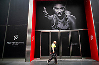 New York - NEW YORK - MAY 05: A man walks in front of a Peloton studios on May 05, 2021 in New York. Peloton company has recalled both of its treadmill models after the death of a 6-year-old child and been received 72 reports of adults, children, pets injured, the company and the US Consumer Product Safety Commission announced. (Photo by John Smith/VIEWpress)