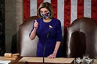 Speaker of the House Nancy Pelosi, D-Calif., arrives as a joint session of the House and Senate convenes to count the Electoral College votes cast in November's election, at the Capitol in Washington, Wednesday, Jan. 6, 2021.<br /> CAP/MPI/RS<br /> ©RS/MPI/Capital Pictures