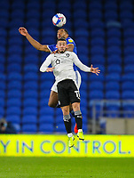 3rd November 2020; Cardiff City Stadium, Cardiff, Glamorgan, Wales; English Football League Championship Football, Cardiff City versus Barnsley; Conor Chaplin of Barnsley looses out to the header from Curtis Nelson of Cardiff City