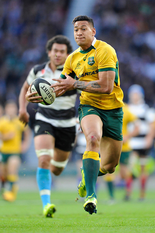 Israel Folau of Australia in full flight during the Killik Cup match between Barbarians and Australia at Twickenham Stadium on Saturday 1st November 2014 (Photo by Rob Munro)