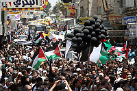 """Gaza.15.05.2008.Palestinians gather during a rally marking the 'Nakba' (Catastrophe) in the West Bank city of Ramallah. Palestinians protested across the occupied territories on the 60th anniversary of the 'catastrophe' of the birth of Israel today as the Jewish state's army went on high alert. The commemoration of the Naqba, or 'catastrophe' -- the defeat of five invading Arab armies and the expulsion or flight of about 760,000 people -- comes as US President George W. Bush addresses Israel's parliament.""""phto Iyad Jadalah"""""""
