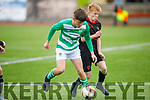 Park FC David O'Callaghan putting Adam Segal of Listowel Celtic under pressure in the Denny Youths final