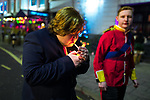 © Joel Goodman - 07973 332324 . 27/12/2017. Wigan, UK. Donald Trump lights a cigarette. Revellers in Wigan enjoy Boxing Day drinks and clubbing in Wigan Wallgate . In recent years a tradition has been established in which people go out wearing fancy-dress costumes on Boxing Day night . Photo credit : Joel Goodman