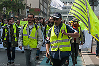 May Day Paris. Trade Unionists, leftists, students and 'Gilets Jaunes' protest against the neoliberal reforms of President Macron. There were several clashes with Police who responded with tear gas and baton charges. Paris, France 1-5-19
