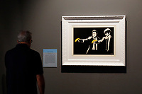 Exhibition of the artist Bansky, titled A visual Protest, at Chiostro del Bramante in Rome. In the picture the painting Pulp Fiction<br /> Rome (Italy), September 10th 2020<br /> Photo Samantha Zucchi Insidefoto