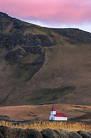 Numerous times during my 10 days in Iceland, we would be photographing in one direction and there was an equally beautiful scene in the opposite direction.  Our goal on this particular morning was to photograph some jagged sea stacks and the sunrise just behind me.  Turning around I liked the light on this lone church. Very evident in the full size photo are marks on the grassy slop behind the church from a dislodged boulder scaring the land.
