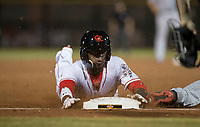 Scottsdale Scorpions second baseman Shed Long (6), of the Cincinnati Reds organization, slides into third base during an Arizona Fall League game against the Salt River Rafters at Scottsdale Stadium on October 12, 2018 in Scottsdale, Arizona. Scottsdale defeated Salt River 6-2. (Zachary Lucy/Four Seam Images)