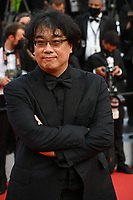 """CANNES, FRANCE. July 6, 2021: Bong Joon-ho at the premiere of """"Annette"""" at the gala opening of the 74th Festival de Cannes.<br /> Picture: Paul Smith / Featureflash"""