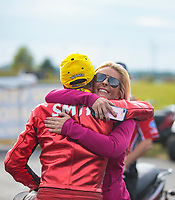 Oct 14, 2018; Concord, NC, USA; NHRA pro stock motorcycle rider Matt Smith celebrates with wife Angie Smith after winning the Carolina Nationals at zMax Dragway. Mandatory Credit: Mark J. Rebilas-USA TODAY Sports