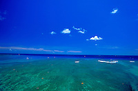 Expansive brilliant blue ocean meets the beautiful blue sky off Waikiki.