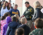 Sgt. Daniel Gonzales pairs 170 elementary students with local heroes as part of the Holiday with a Hero program at Walmart in Carson City, Nev., on Tuesday, Dec. 17, 2013. The community event partners military, firefighters, law enforcement and medical personnel with local Students in Transition to provide them with Christmas presents.<br /> Photo by Cathleen Allison