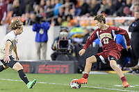 Houston, TX - Friday December 9, 2016: Karsten Hanlin (17) of the Denver Pioneers keeps the ball from going out of bounds against the Wake Forest Demon Deacons at the NCAA Men's Soccer Semifinals at BBVA Compass Stadium in Houston Texas.