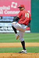 Joan Montero (49) of the Altoona Curve pitches during a game against the New Britian Rock Cats at New Britain Stadium on June 25, 2014 in New Britain, Connecticut.  New Britain defeated Altoona 3-1.  (Gregory Vasil/Four Seam Images)
