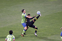COLUMBUS, OH - DECEMBER 12: Luis Diaz #12 of the Columbus Crew clears the ball away from Gustav Svensson #4 of the Seattle Sounders FC with an overhead kick during a game between Seattle Sounders FC and Columbus Crew at MAPFRE Stadium on December 12, 2020 in Columbus, Ohio.