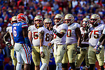 Seminole quarterback Jameis Winston (5) leads his team in the 2nd half of the #2 ranked Florida State Seminoles 37-7 victory over the Florida Gators at Ben Hill Griffin Stadium in Gainesville, Florida November 30, 2013.  Winston had 327 yards passing and 3 touchdowns to finish off Florida State's undefeated regular season at 12-0.