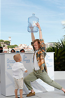 """CANNES, FRANCE - JULY 17: Kylian Dheret and Alex Lutz at the """"Vortex"""" photocall during the 74th annual Cannes Film Festival on July 17, 2021 in Cannes, France. <br /> CAP/GOL<br /> ©GOL/Capital Pictures"""