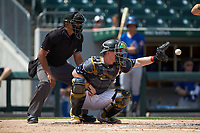 Charlotte Knights catcher Zack Collins (8) receives a pitch as home plate umpire Erich Bacchus looks on during the game against the Durham Bulls at BB&T BallPark on May 27, 2019 in Charlotte, North Carolina. The Bulls defeated the Knights 10-0. (Brian Westerholt/Four Seam Images)