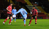 Lincoln City's Tayo Edun handles the ball under pressure from Manchester City U21's Claudio Gomes<br /> <br /> Photographer Chris Vaughan/CameraSport<br /> <br /> EFL Papa John's Trophy - Northern Section - Group E - Lincoln City v Manchester City U21 - Tuesday 17th November 2020 - LNER Stadium - Lincoln<br />  <br /> World Copyright © 2020 CameraSport. All rights reserved. 43 Linden Ave. Countesthorpe. Leicester. England. LE8 5PG - Tel: +44 (0) 116 277 4147 - admin@camerasport.com - www.camerasport.com