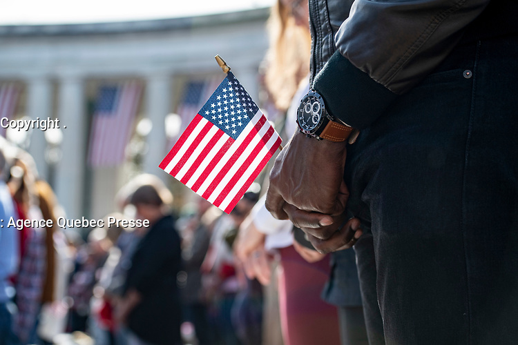 Visitors attend the National Veterans Day Observation in the Memorial Amphitheater at Arlington National Cemetery, Arlington, Virginia, Nov. 11, 2019. Vice President Mike Pence with Secretary of Veterans Affairs Robert Wilkie participated in a wreath-laying ceremony at the Tomb of the Unknown Soldier and spoke to the crowd in the Memorial Amphitheatre as part of the observance. (U.S. Army photo by Elizabeth Fraser / Arlington National Cemetery / released)