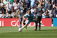 ST. PAUL, MN - AUGUST 21: Johnny Russell #7 of Sporting Kansas City runs into Romain Metanire #19 of Minnesota United FC during a game between Sporting Kansas City and Minnesota United FC at Allianz Field on August 21, 2021 in St. Paul, Minnesota.