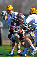 17 March 2012: University of Vermont Catamount Defender Makoa Kaleo, a Freshman from Charlotte, VT, checks Tim Caton during a game against the Sacred Heart University Pioneers at Virtue Field in Burlington, Vermont. The Catamounts defeated the visiting Pioneers 12-11 with only 10 seconds remaining in their non-conference matchup. Mandatory Credit: Ed Wolfstein Photo