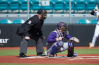 Western Carolina Catamounts catcher Michael Goehrig (10) sets a target as home plate umpire Andrew Glenn looks on during the game against the Kennesaw State Owls at Springs Brooks Stadium on February 22, 2020 in Conway, South Carolina. The Owls defeated the Catamounts 12-0.  (Brian Westerholt/Four Seam Images)