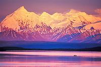 Canoers paddle Wonder Lake, Mt. Brooks of the Alaska Range, Denali National Park, Alaska
