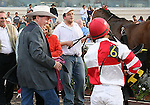 7 February 2009:  Jockey Gabriel Saez gets congratulated by a smiling trainer Larry Jones after  winning the Risen Star Stakes aboard Friesan Fire at the Fair Grounds Race Course in New Orleans, Louisiana.