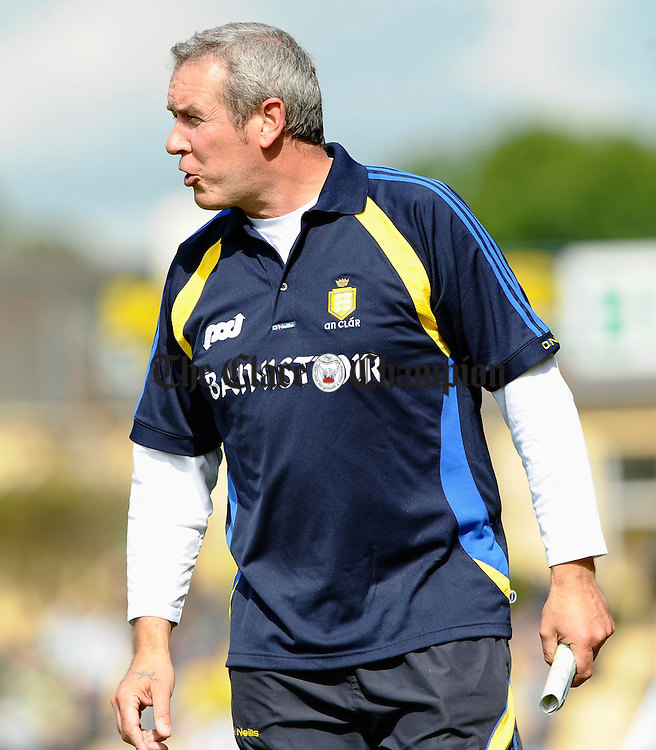 Clare manager Frank Doherty urges on his charges during their senior championship game in Killarney. Photograph by John Kelly.