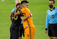 CARSON, CA - OCTOBER 28: Eduard Atuesta #20 of LAFC and Mauro Manotas #9 of the Houston Dynamo during a game between Houston Dynamo and Los Angeles FC at Banc of California Stadium on October 28, 2020 in Carson, California.