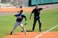 Atlanta Braves third baseman Edward Salcedo throws to first as umpire Jason Werly makes the call for a fair ball during a minor league Spring Training game against the Baltimore Orioles at Al Lang Field on March 13, 2013 in St. Petersburg, Florida.  (Mike Janes/Four Seam Images)