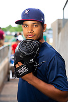 Northwest Arkansas Naturals pitcher Gerson Garabito (15) poses for a photo on May 1, 2019, at Arvest Ballpark in Springdale, Arkansas. (Jason Ivester/Four Seam Images)