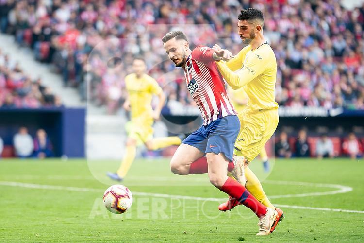Saul Niguez of Atletico de Madrid and Alvaro Gonzalez of Villareal CF during La Liga match between Atletico de Madrid and Villareal CF at Wanda Metropolitano in Madrid Spain. February 24, 2018. (ALTERPHOTOS/Borja B.Hojas)
