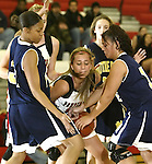 SOUTHBURY, CT, 01/02/08- 010208BZ06- Pomperaug's Lizzie Dunbar (11) wrestles for the ball with from Notre Dame's Jesika Holmes (32), left, and Christine Rivera (15) during their game at Pomperaug High School in Southbury Wednesday night.<br /> Jamison C. Bazinet Republican-American