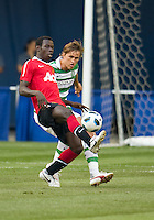 July 16, 2010 Mame Biram Diouf No. 32 of Manchester United and Thomas Rogne No. 25 of Celtic FC during an international friendly between Manchester United and Celtic FC at the Rogers Centre in Toronto.