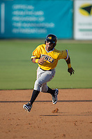 Elvis Escobar (3) of the West Virginia Power hustles towards third base against the Kannapolis Intimidators at CMC-Northeast Stadium on April 21, 2015 in Kannapolis, North Carolina.  The Power defeated the Intimidators 5-3 in game one of a double-header.  (Brian Westerholt/Four Seam Images)