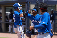FCL Blue Jays Glenn Santiago (49) celebrates hitting a home run with Amell Brazoban (10) during a game against the FCL Yankees on June 29, 2021 at the Yankees Minor League Complex in Tampa, Florida.  (Mike Janes/Four Seam Images)