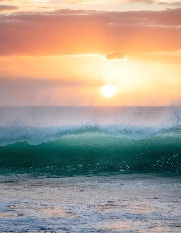 Sunset and waves at Hapuna Beach. Hawaii Island