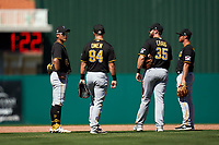 Pittsburgh Pirates shortstop Ji-Hwan Bae (90), third baseman Hunter Owen (94), first baseman Will Craig (35), and second baseman Kevin Kramer (65) during a Major League Spring Training game against the Minnesota Twins on March 16, 2021 at Hammond Stadium in Fort Myers, Florida.  (Mike Janes/Four Seam Images)